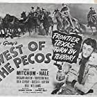 Robert Mitchum and Barbara Hale in West of the Pecos (1945)