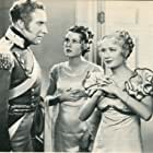 Frances Dee, Miriam Hopkins, and Alan Mowbray in Becky Sharp (1935)