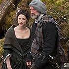 Graham McTavish and Caitriona Balfe in Outlander (2014)