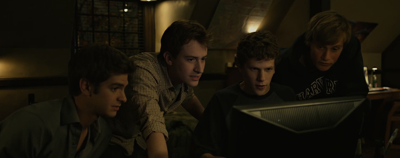 Joseph Mazzello, Jesse Eisenberg, and Andrew Garfield in The Social Network (2010)