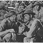 Robert Taylor, Lee Bowman, Roque Espiritu, Thomas Mitchell, George Murphy, Barry Nelson, Phil Schumacher, and Robert Walker in Bataan (1943)