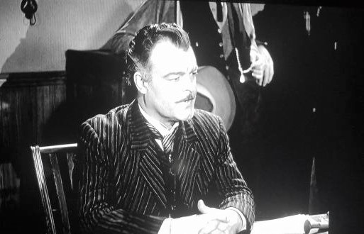 John Merton in Flame of the West (1945)