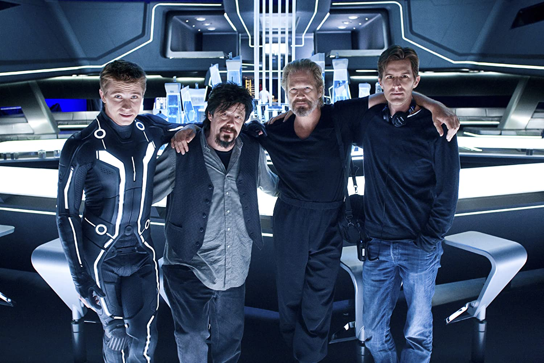 Jeff Bridges, Steven Lisberger, Garrett Hedlund, and Joseph Kosinski in Tron (2010)
