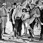 Yakima Canutt, Ray Corrigan, Robert Livingston, Mary Russell, Max Terhune, John Van Pelt, and Roger Williams in Riders of the Whistling Skull (1937)