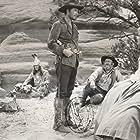 Errol Flynn, Chubby Johnson, Nakai Snez, and Patrice Wymore in Rocky Mountain (1950)