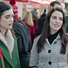 Jessica Lowndes and Justine Cotsonas in Rediscovering Christmas (2019)