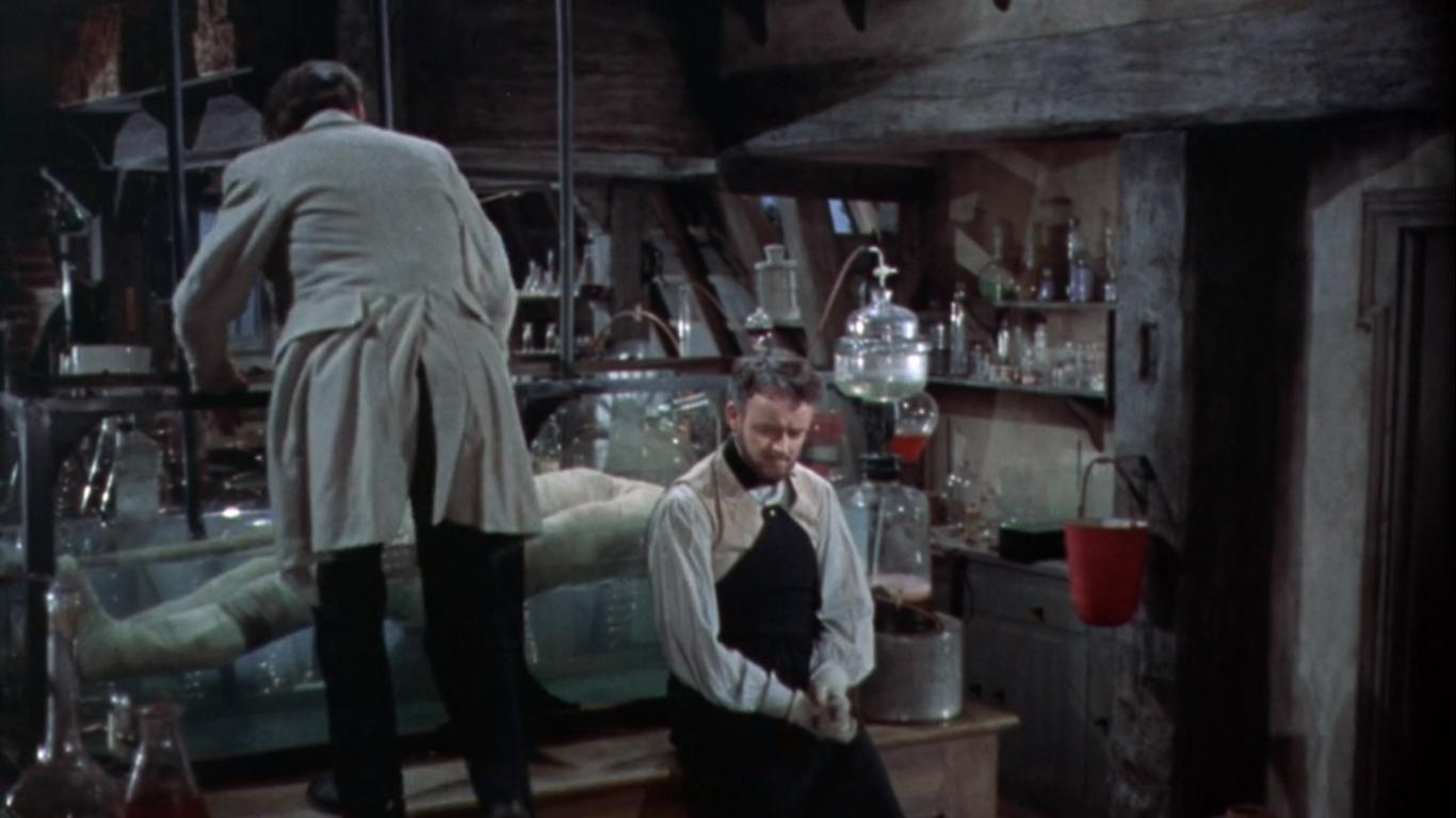 Peter Cushing and Robert Urquhart in The Curse of Frankenstein (1957)