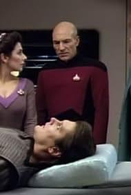 Gates McFadden, Marina Sirtis, Patrick Stewart, and John Vickery in Star Trek: The Next Generation (1987)
