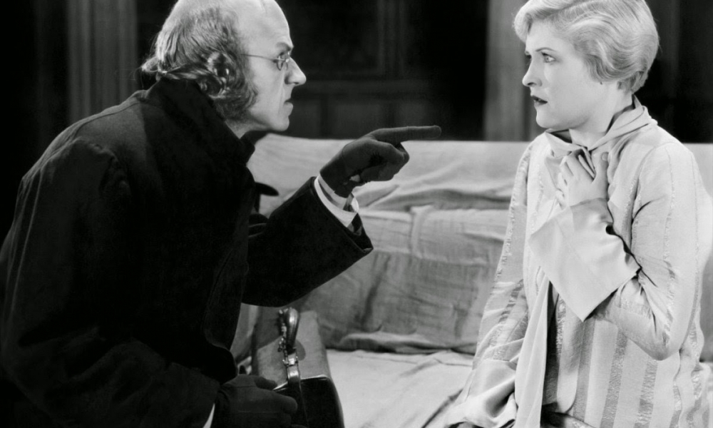 Laura La Plante and Lucien Littlefield in The Cat and the Canary (1927)