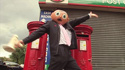 Frank Sidebottom, fondly remembered as the man with the papier mache head, was the court jester of the Manchester music and comedy scene for over 25 years but only a privileged few knew the man inside - Chris Sievey. This documentary tells a twisted tale of split personalities - a suburban creative superhero with a fanatical desire to preserve the myth he created, and eventually having to battle against being consumed by his alter ego.