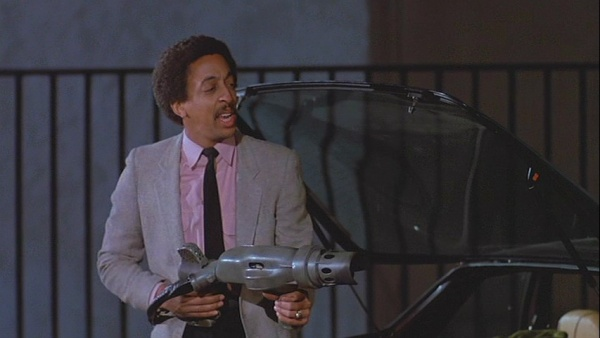 Gregory Hines in Deal of the Century (1983)