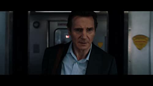 A businessman is caught up in a criminal conspiracy during his daily commute home.