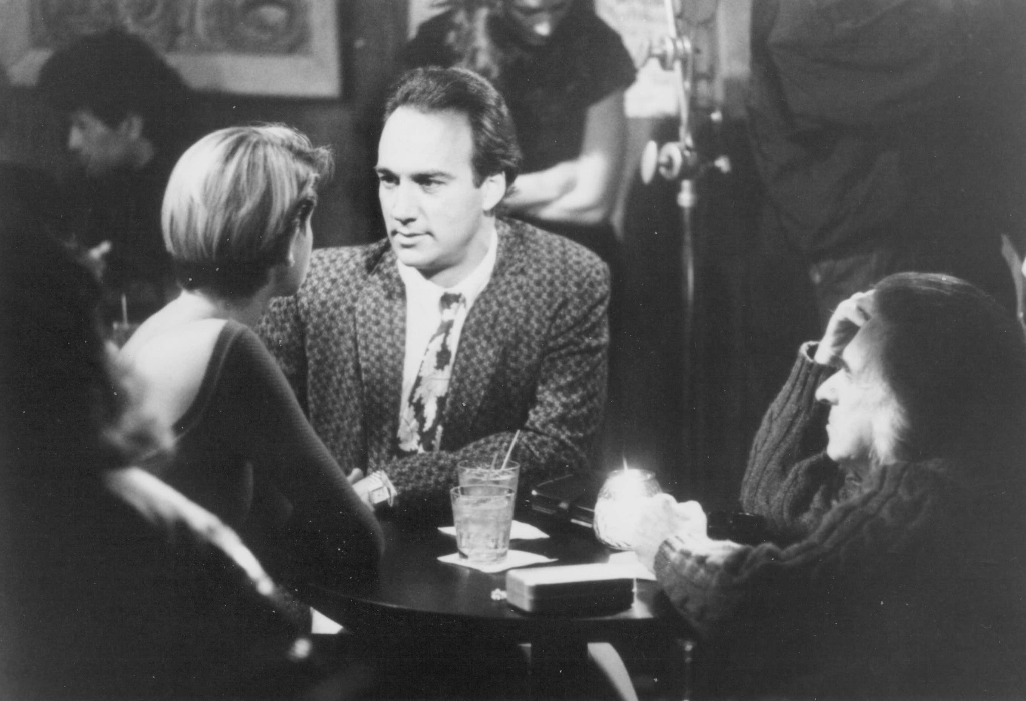Jim Belushi, Arthur Hiller, and Loryn Locklin in Taking Care of Business (1990)