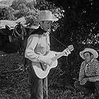 Tex Ritter and Glenn Strange in Song of the Gringo (1936)