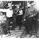 Bob Custer, Ralph McCullough, and Mary Beth Milford in Galloping Vengeance (1925)