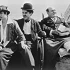 Charles Chaplin, Jess Dandy, and Peggy Page in His New Profession (1914)