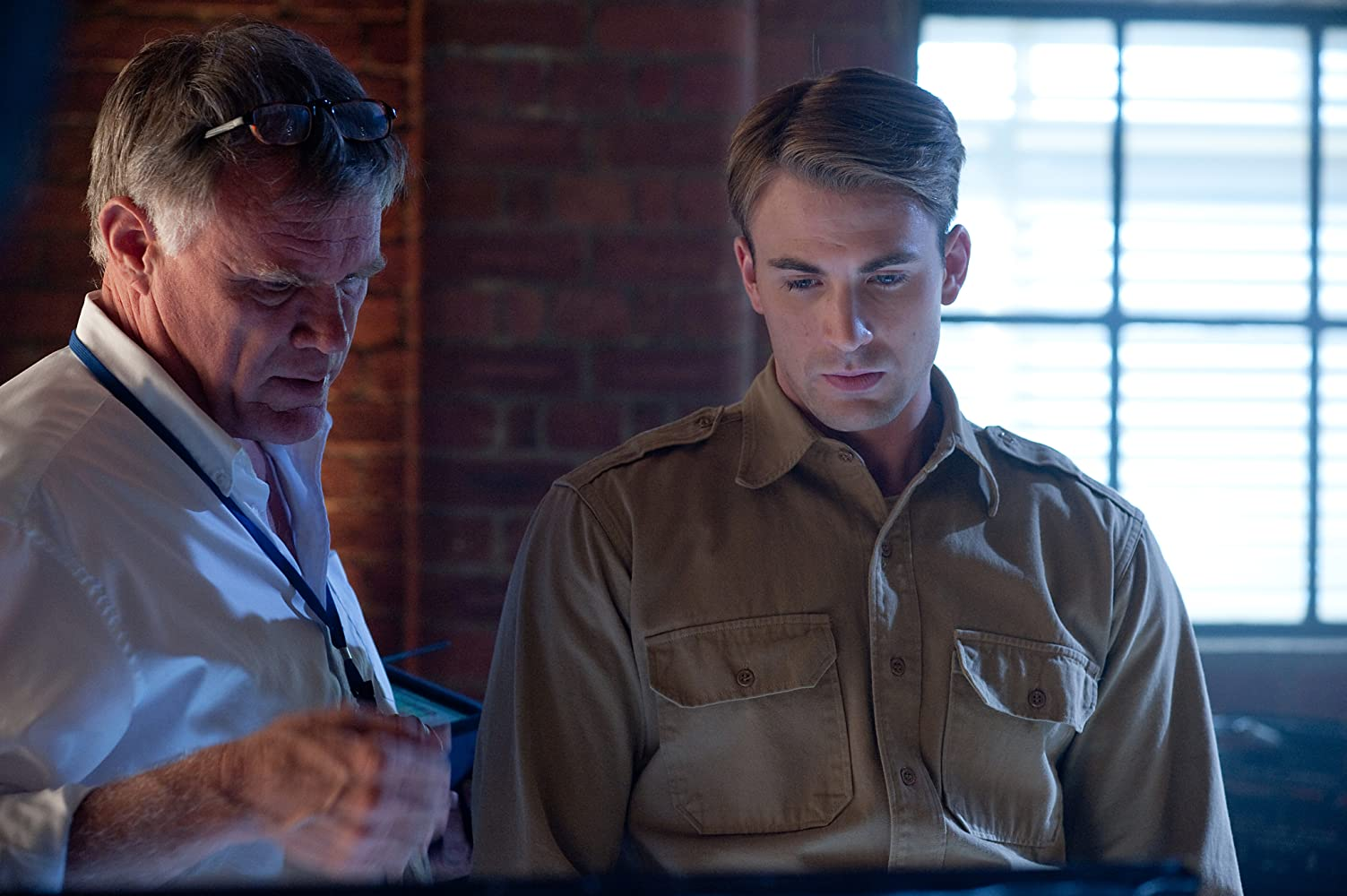Joe Johnston and Chris Evans in Captain America: The First Avenger (2011)