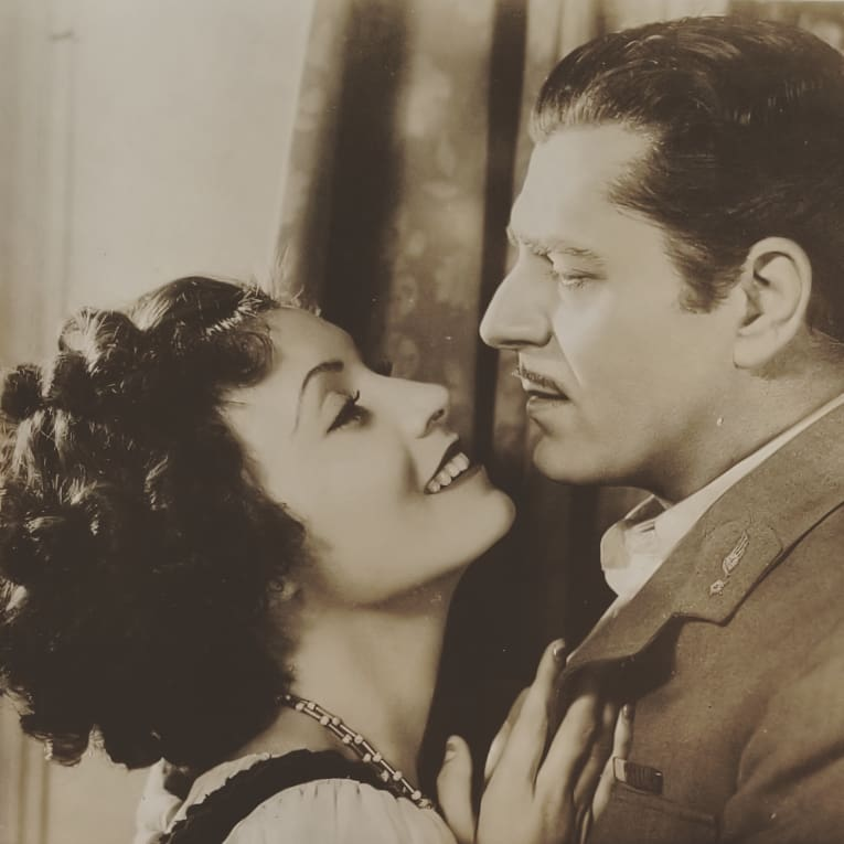 Warner Baxter and Conchita Montenegro in Hell in the Heavens (1934)