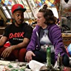 Betsy Sodaro and Chris Redd in Disjointed (2017)