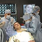 Jesse Spencer, Amber Tamblyn, and Chad Faust in House M.D. (2004)