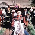Howard Keel, Foy Willing, and Foy Willing's Orchestra in Texas Carnival (1951)