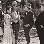 Roy Rogers, Chester Gunnels, Frank Jaquet, Lynne Roberts, and Joe Whitehead in Shine on Harvest Moon (1938)