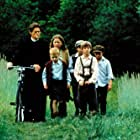 Willem Dafoe, Haley Joel Osment, Olga Frycz, and Liam Hess in Edges of the Lord (2001)