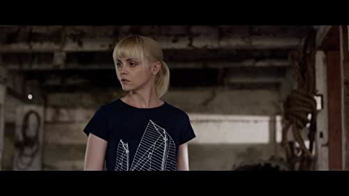 A 32-year-old woman suffering from bipolar disorder comes to suspect the proprietor of the state-of-the-art ''smart apartment'' she and her husband just moved into is using the building's residents as unwitting guinea pigs for a ''synthetic telepathy'' brainwashing plot with dire global ramifications.