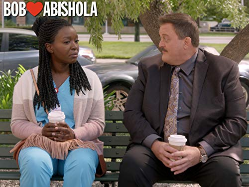 Billy Gardell and Folake Olowofoyeku in Bob Hearts Abishola (2019)