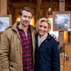 Nicky Whelan and Josh Kelly in Romance at Reindeer Lodge (2017)