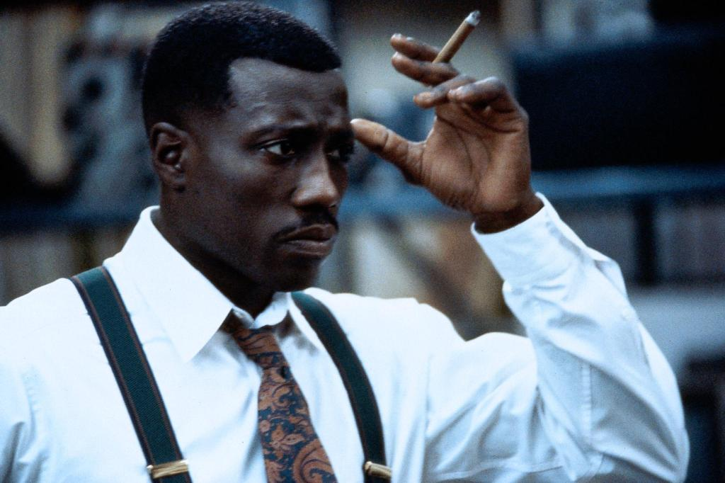 Wesley Snipes smoking a cigarette (or weed)