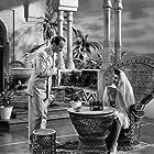 George Sanders and Lenore Aubert in Action in Arabia (1944)