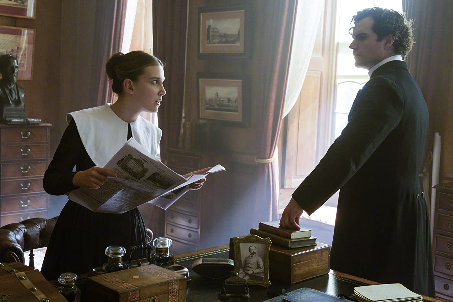 Henry Cavill and Millie Bobby Brown in Enola Holmes (2020)