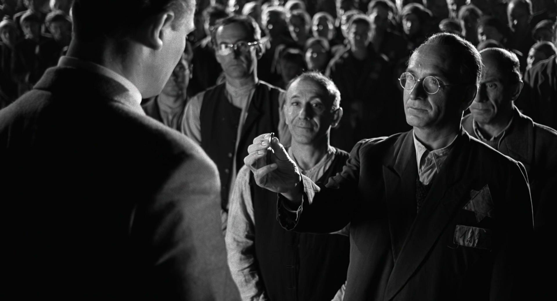 Liam Neeson, Ben Kingsley, and Ezra Dagan in Schindler's List (1993)