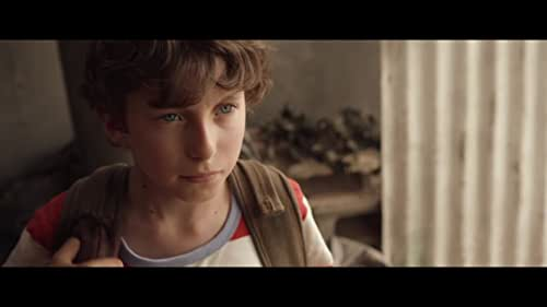 A young boy challenges a villainous bully to a game of marbles in a bizarre and fantastical world where marbles are as precious as gold.