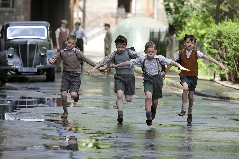 Asa Butterfield, Henry Kingsmill, Domonkos Németh, and Zac Mattoon O'Brien in The Boy in the Striped Pyjamas (2008)