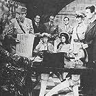 Edgar Barrier, Tom Brown, Rose Hobart, Marjorie Lord, Keye Luke, and Sidney Toler in The Adventures of Smilin' Jack (1943)
