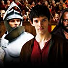 Adrian Lester, Angel Coulby, Colin Morgan, and Bradley James in Merlin (2008)