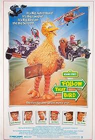 Chevy Chase, Sandra Bernhard, John Candy, Joe Flaherty, Waylon Jennings, Caroll Spinney, Dave Thomas, and Big Bird in Follow That Bird (1985)