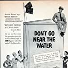 Glenn Ford, Eva Gabor, Anne Francis, Earl Holliman, and Gia Scala in Don't Go Near the Water (1957)
