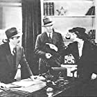 Mae Busch, Jon Hall, and Bryant Washburn in The Amazing Exploits of the Clutching Hand (1936)