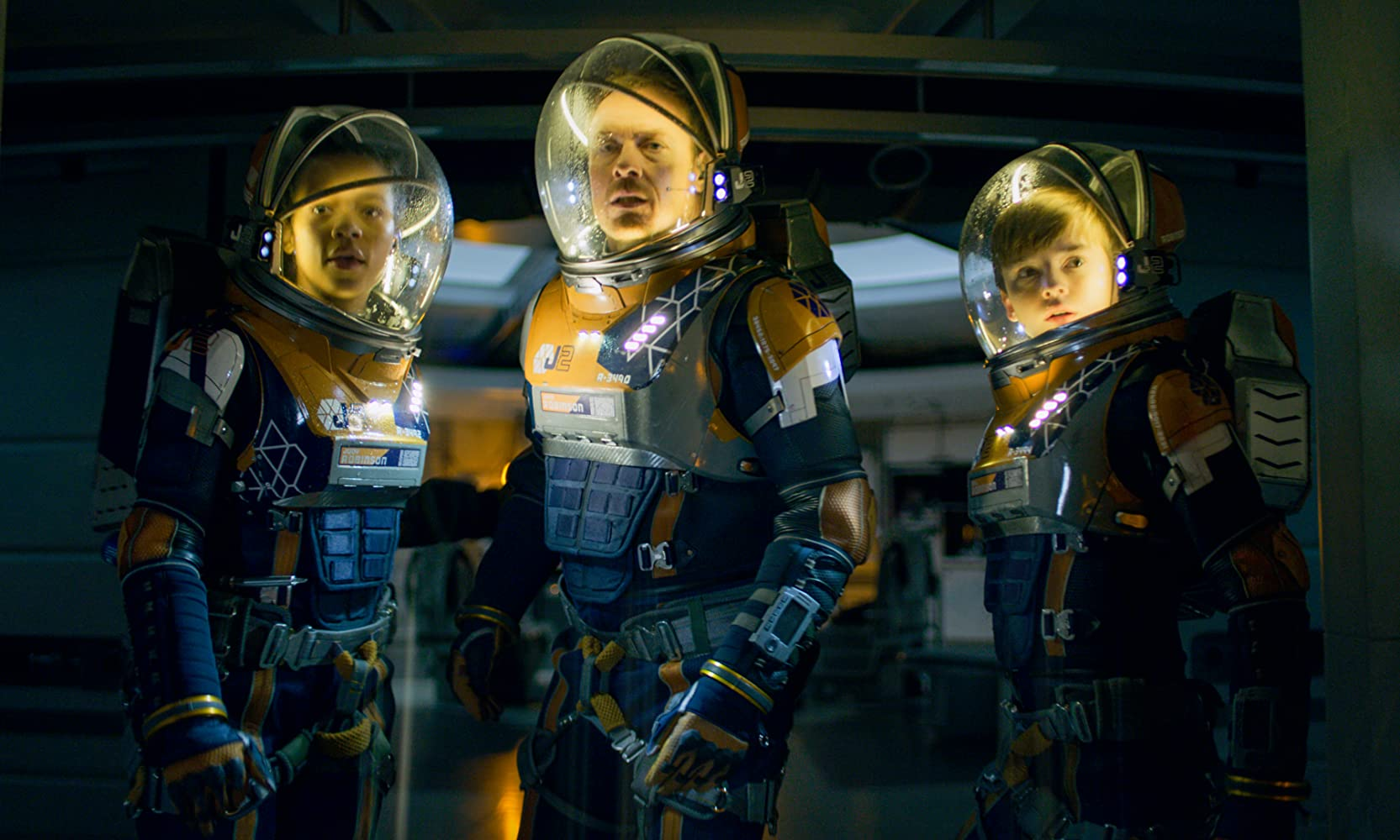 Toby Stephens, Maxwell Jenkins, and Taylor Russell in Lost in Space (2018)