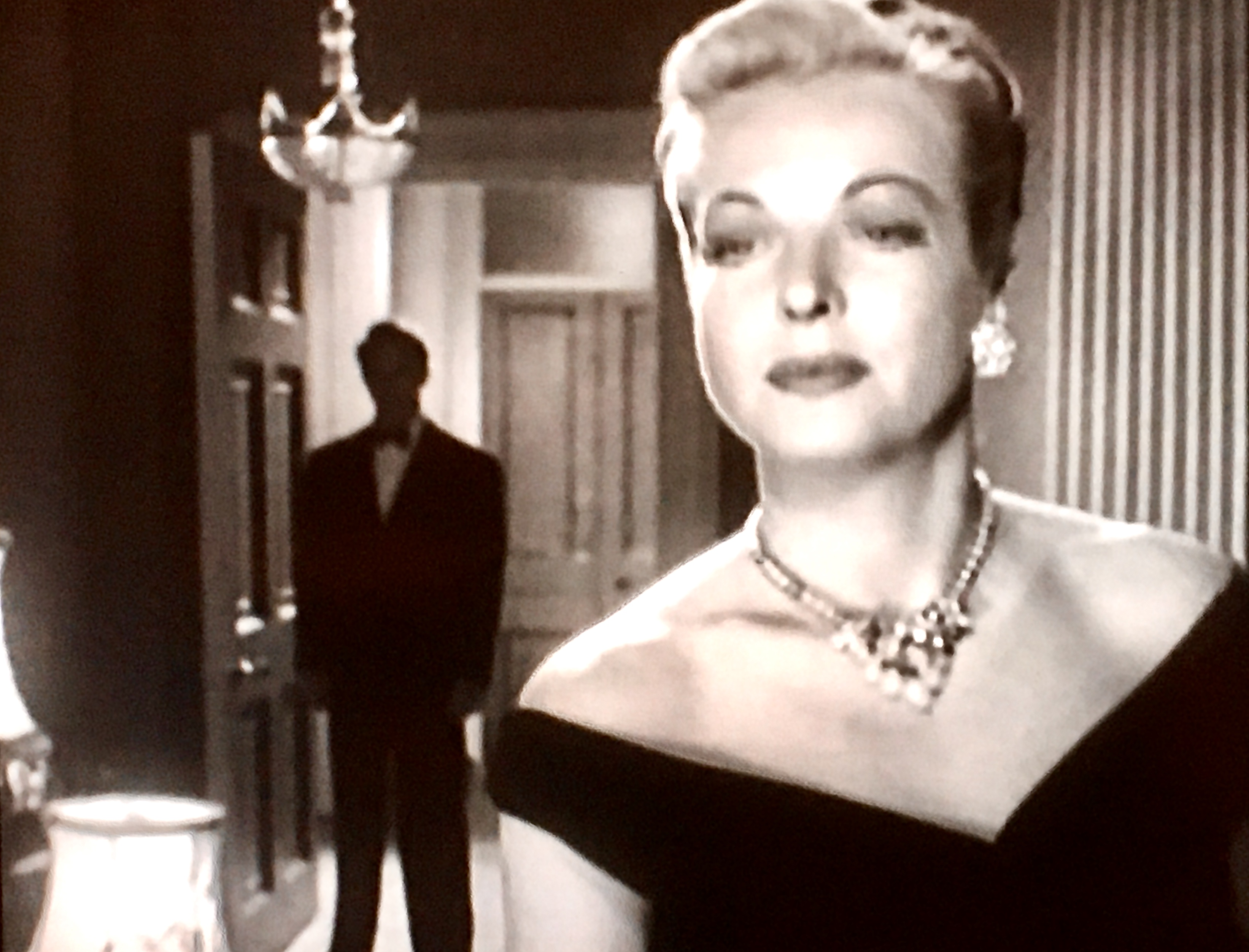 Hillary Brooke and Alex Nicol in The House Across the Lake (1954)