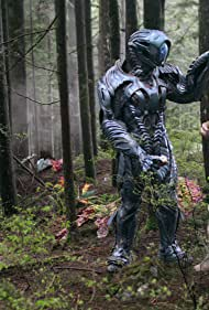 Brian Steele and Maxwell Jenkins in Lost in Space (2018)