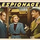 Madge Evans, Robert Graves, and Edmund Lowe in Espionage (1937)