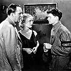 Bette Davis, Pat O'Brien, and Junior Durkin in Hell's House (1932)