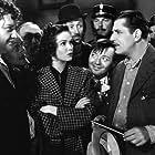 Peter Lorre, John Carradine, Warner Baxter, Charles Halton, Jean Hersholt, and Marjorie Weaver in I'll Give a Million (1938)
