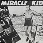 Carol Hughes, Vickie Lester, and Tom Neal in The Miracle Kid (1941)