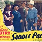 Gene Autry, Irving Bacon, Damian O'Flynn, Lynne Roberts, and Jean Van in Saddle Pals (1947)