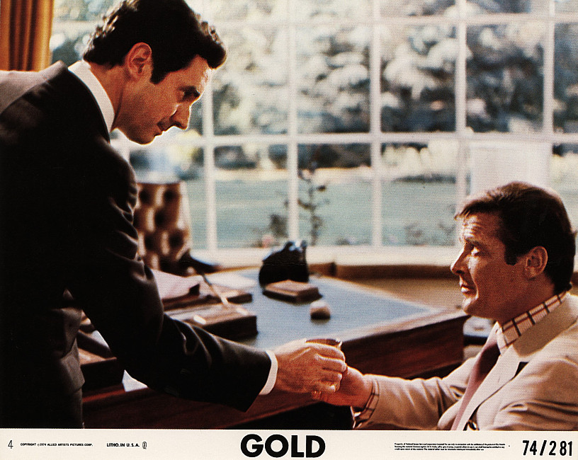 Roger Moore and Bradford Dillman in Gold (1974)